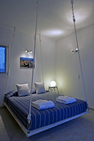 modern shape of bed in Almira villa